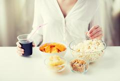 Close up of woman with junk food and cola cup Stock Photos