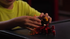 Boy playing with toys - Lego building blocks #4 Stock Footage
