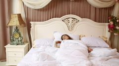 Woman stretching in bed after wake up. luxury interior - stock footage