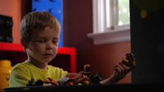 Young Child playing with Lego building blocks #6 Stock Footage