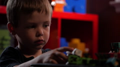 Young Boy - Playing with toys Stock Footage
