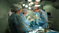 Surgical team operating. Doctors in protective clothing Stock Footage