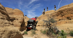 Off road 4x4 red jeep climb steep dangerous mountain 3 DCI 4K - stock footage