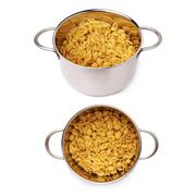 Set of metal pan filled with dry conchiglie pasta over isolated white background Stock Photos