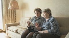 The old woman and her friend looking at pictures Stock Footage