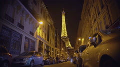 Majestic illuminated Eiffel Tower sparkling at night, romantic symbol of Paris Stock Footage