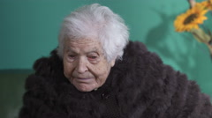 Tired old woman with her pelt Stock Footage