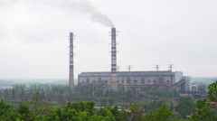 Working coal-fired power plant with high tubes and smoke Stock Footage