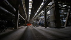 4K Team of engineers in power station, wide shot of workers & interior structure Stock Footage