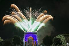 Happy new year fireworks on triumph arc in Genoa Italy Stock Photos