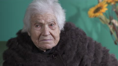 Very old woman sitting and bored  watching around Arkistovideo