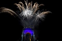 Happy new year fireworks on triumph arc in Genoa Italy - stock photo