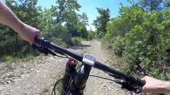 Man going on mountain bike on dirt trail. - stock footage