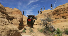 Off road 4x4 red jeep climb steep dangerous mountain 4 DCI 4K Stock Footage