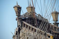 Gold statues on pirate sail ship detail Stock Photos