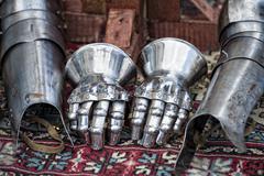 Antique metallic medieval armor gloves detail Stock Photos