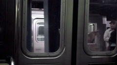 Window view of subway train departing from across platform in NYC Stock Footage