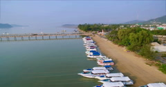 Aerial Drone Pullback Shot Over Speedboats On Tropical Beach Stock Footage