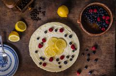 Lemon cheesecake with berries Stock Photos