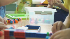 Children play intellectual games at a kindergarten - stock footage