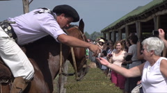 Gauchos offer ring to lady after ring lancing contest, Argentina - stock footage