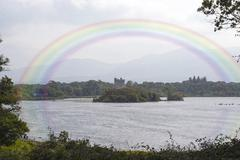 rainbow view of ross castle - stock photo