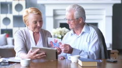Elderly couple having fun in communicating with family on the internet in - stock footage