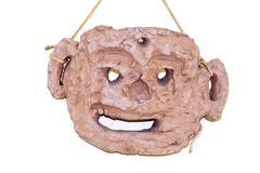 Terracotta earthenware greek tragedy style mask Stock Photos