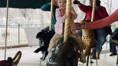 Little Girl Riding a Carousel Wide Stock Footage