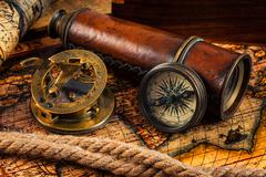 Old vintage compass and navigation instruments on ancient map - stock photo
