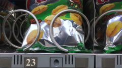 Chips coming out of vending machine in Valencia Spain 4k Stock Footage
