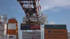 Container loads onto ship by overhead gantry, Buenos Aires, Argentina, dolly Stock Footage