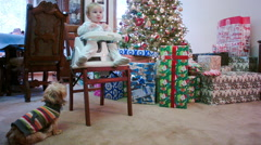 Little Girl Eating on Christmas with a Little Cute Dog Begging Stock Footage