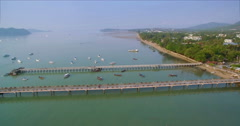 Aerial Pullback Shot Revealing Pier and Boats in Chalong Bay Phuket Stock Footage
