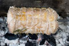 Veal roast while cooking on charcoal barbecue Stock Photos