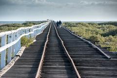 Geraldton antique wood railway jetty - stock photo