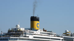 Cruise ship chimney tower expelling black smoke a sunny afternoon Stock Footage