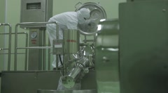 Worker Checking Machinery In Factory Stock Footage