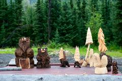 Wood Carved bears and trees in Cooper Landing Alaska Stock Photos