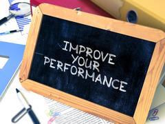 Hand Drawn Improve Your Performance Concept on Small Chalkboard - stock illustration