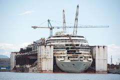 Wreck of Costa Concordia Ship in Genoa Harbor - stock photo