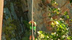 Bungee Jumping. The man hanging on the rope while pulling upward Stock Footage