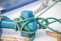 Boat bollard detail on blue sea background Stock Photos