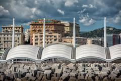 Genoa town cityscape panorama from the sea on cloudy day Stock Photos