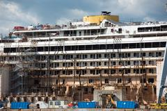 Wreck of Costa Concordia Ship in Genoa Harbor Stock Photos