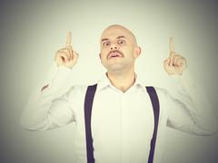 Mustache bald man shows finger up - stock photo