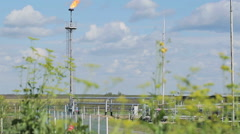 Torch at the facility with pipe and tube for chemical operation Stock Footage