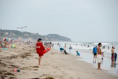 LOS ANGELES, USA - AUGUST 3, 2014 - people on Zuma sandy  beach in summer tim - stock photo