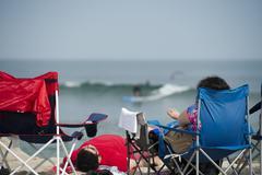 woman relaxing in malibu sandy beach - stock photo