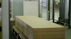 Furniture manufacturing Furniture parts are packaged on automated packaging line Stock Footage